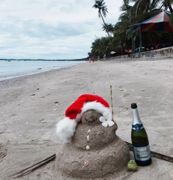 Фото прикол  про сніговика, пляж та новий рік