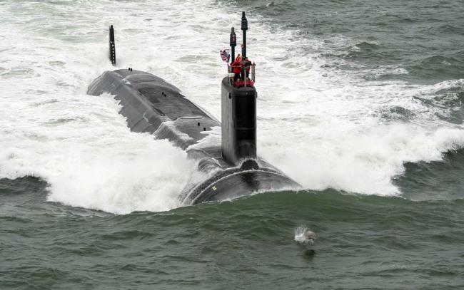 Фото прикол  про підводний човен та дельфінів